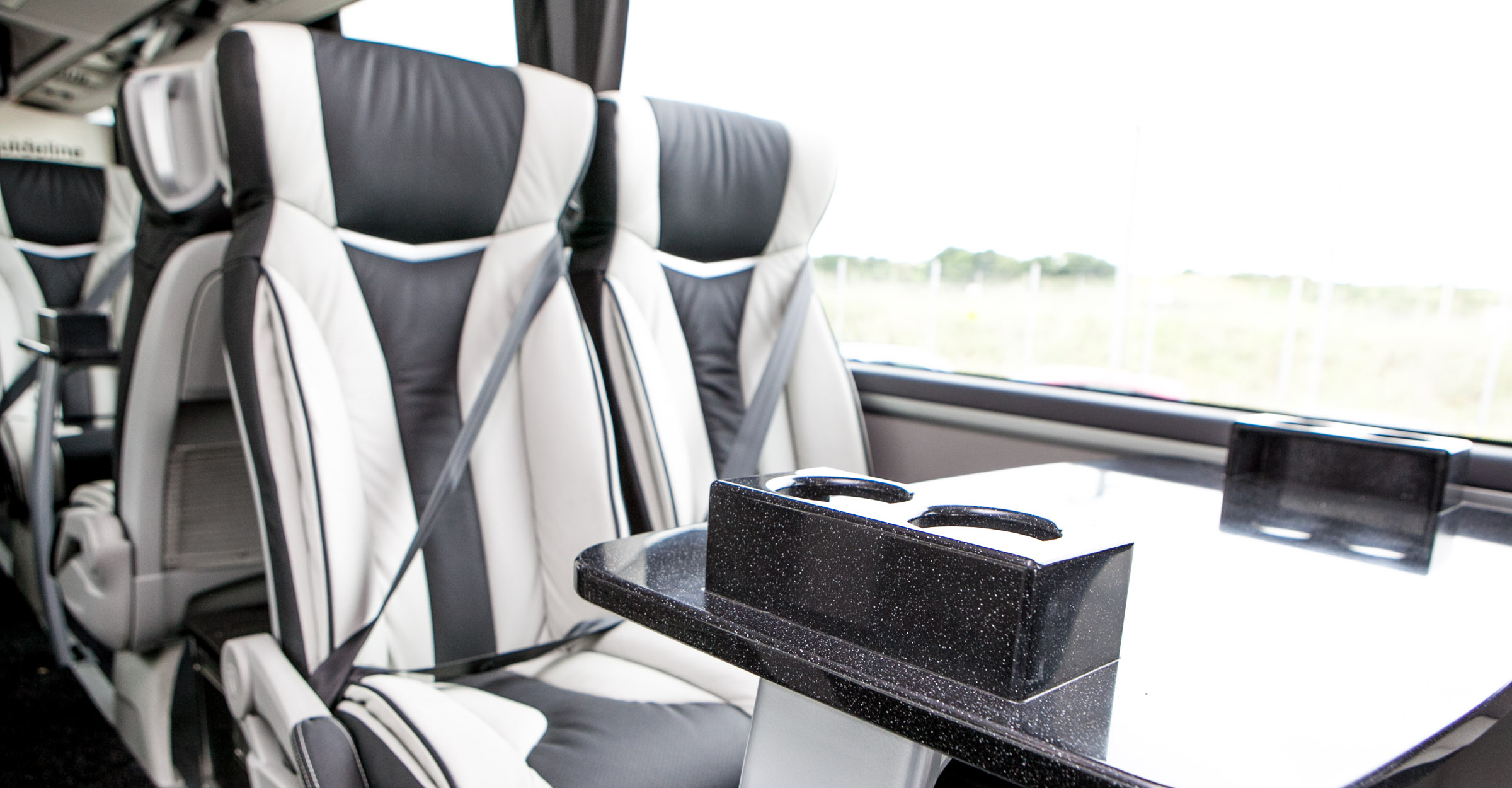 An image of the Interior of a luxury coach.