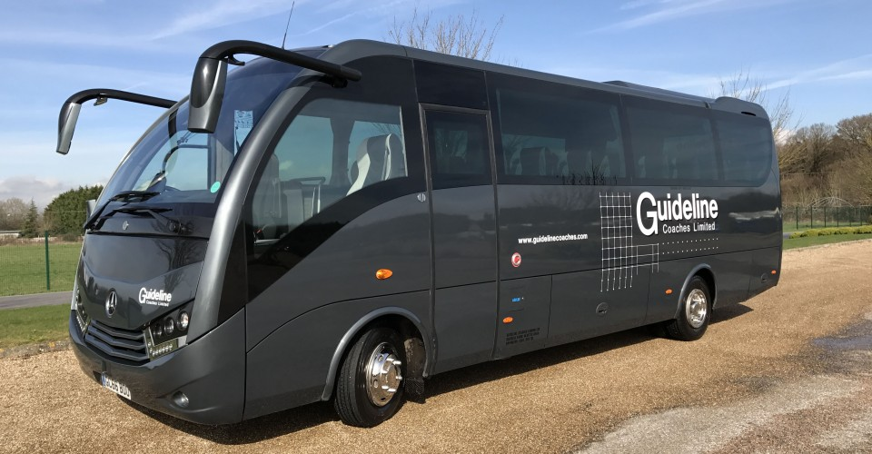 An image showing a premium coach offering executive coach hire by Guideline Coaches