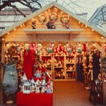 An image of a christmas market, with lots of toys and lights and christmas food. Guideline Coaches can offer coach hire to take people to these christmas markets.